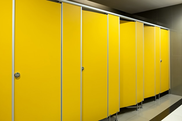 Toilet bathroom yellow door open and close Premium Photo