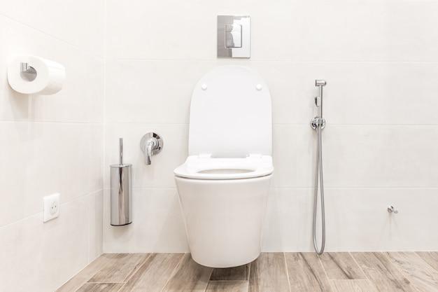 Toilet bowl in modern white hitech bathroom Premium Photo