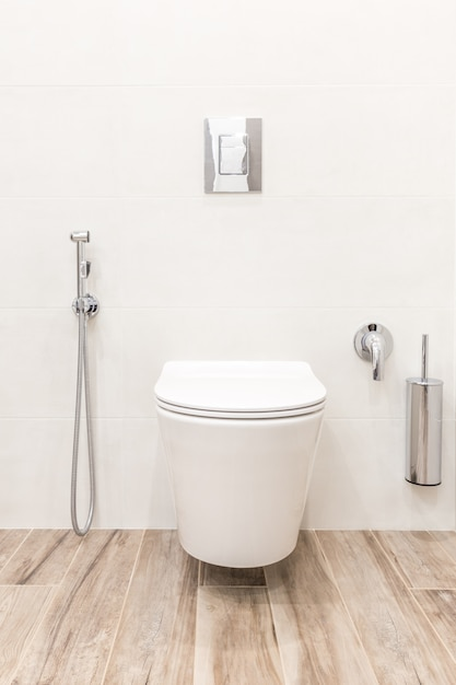Toilet bowl in modern white style bathroom Premium Photo