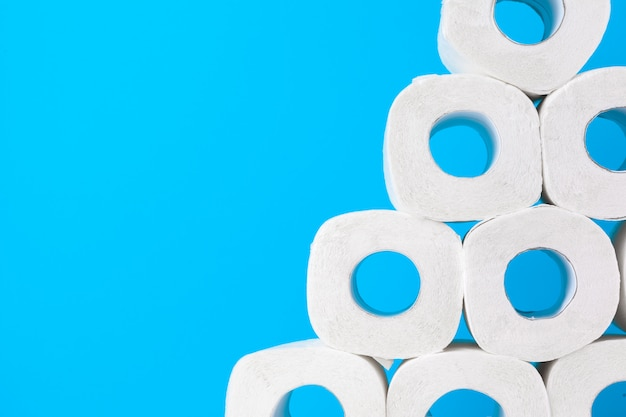 Toilet paper. close up shot on blue background Premium Photo
