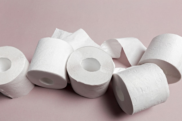 Toilet paper on pink background Premium Photo