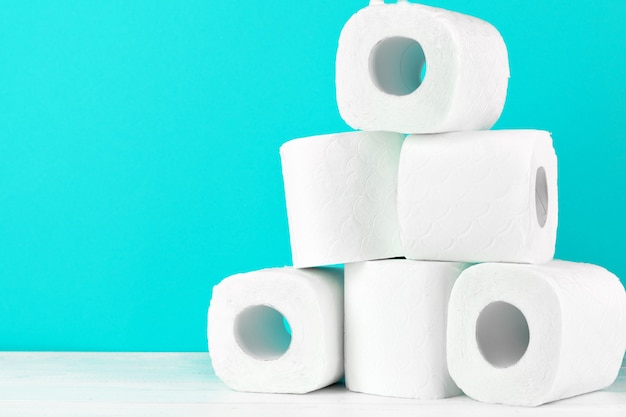 Toilet paper rolls on turquoise Premium Photo