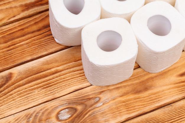 Toilet paper rolls on wooden top view Premium Photo