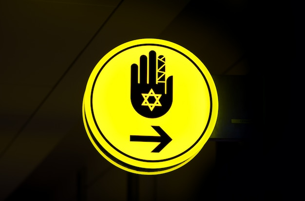 Toilet, wc for hassid (religious jew) sign. bright yellow symbol on dark background. copy space Premium Photo