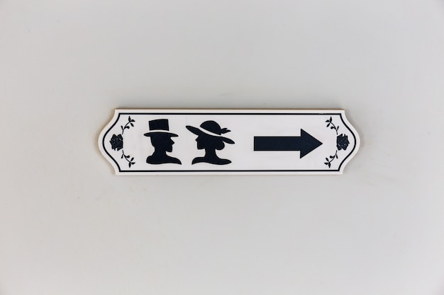 Toilets icon sign wooden with male and female symbol and direction arrow Premium Photo