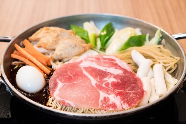 Tokpokki - traditional korean food, hot pot style. Premium Photo