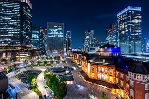 Tokyo railway station and business district building at night, japan. Free Photo