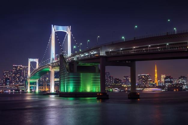 Tokyo skyline with rainbow bridge and tokyo tower. tokyo, japan. Free Photo