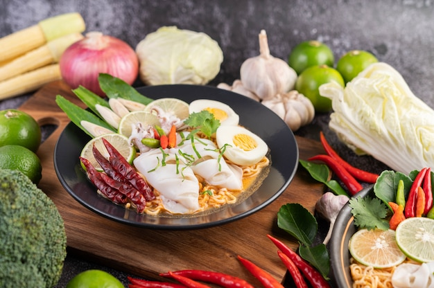 Tom yum mama with squid and boiled egg. Free Photo