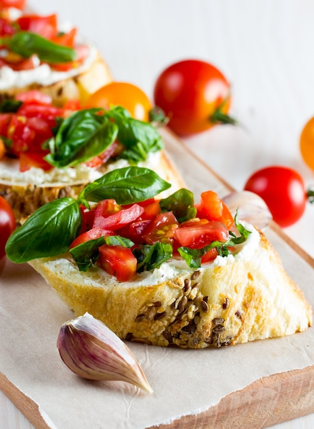 Tomato and cheese fresh made bruschetta. Premium Photo