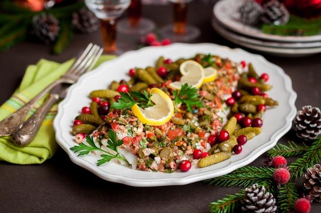 Tomato, herb, nut and gherkin cod fish Premium Photo