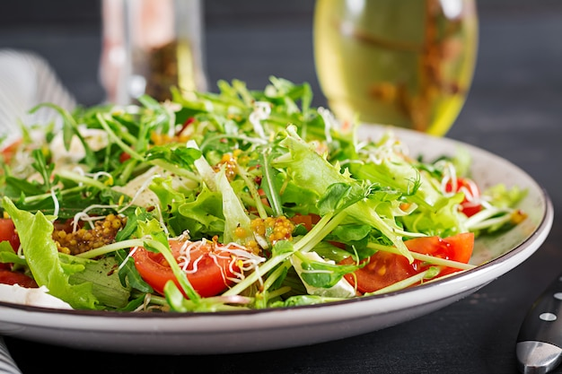 Tomato salad with mix micro greens and  camembert cheese. Premium Photo