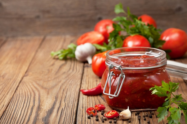 Tomato sauce in a glass jar Premium Photo