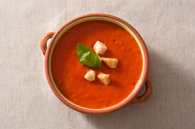 Tomato soup in brown bowl garnished with croutons top view Premium Photo