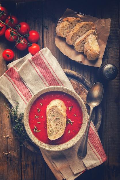 Tomato  soup  and fresh tomatoes cherry Premium Photo
