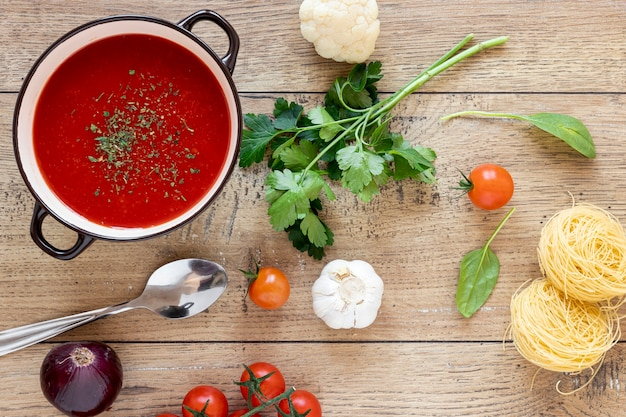 Tomato soup and parsley top view Free Photo
