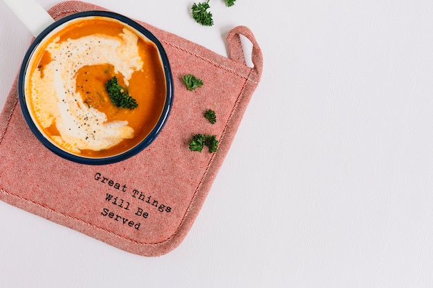 Tomato soup on placemat against white background Free Photo