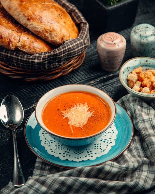 Tomato soup topped with cheese Free Photo