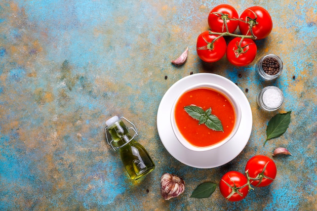 Tomato soup with basil in a bowl. Free Photo