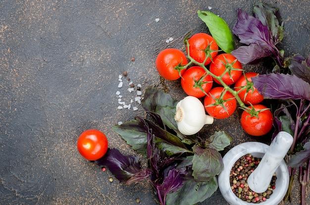 Tomatoes, basil and peper spice Premium Photo