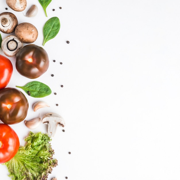Tomatoes near mushrooms and herbs Free Photo