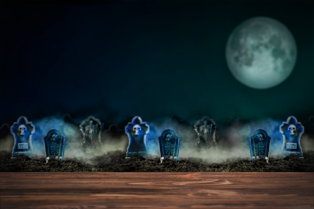 満月の夜の霧の中の墓石 無料写真