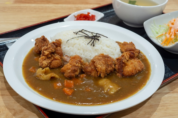 Tongkatsy, japanese fried pork and curry goes with white rice. Premium Photo