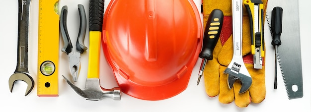 Tool for building a house or repairing an apartment, on a white background. the workplace of the foreman. theme of home and professional repair and construction. copy space for text. banner. Premium Photo