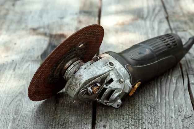 Tool bulgarian lies on a wooden Premium Photo