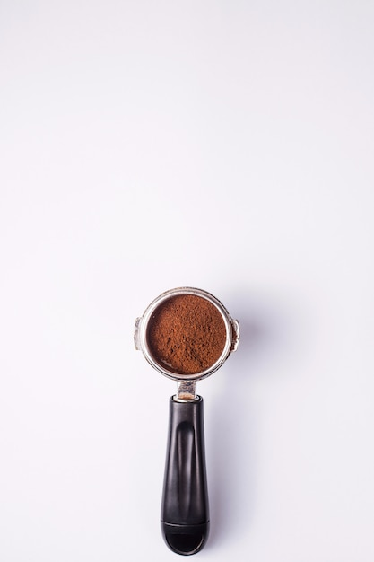 Tool for making professional espresso coffee on a gray table Premium Photo