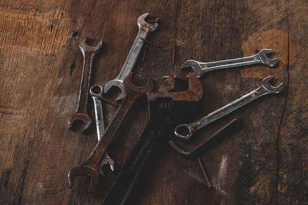 Tool renovation on grunge wood Premium Photo