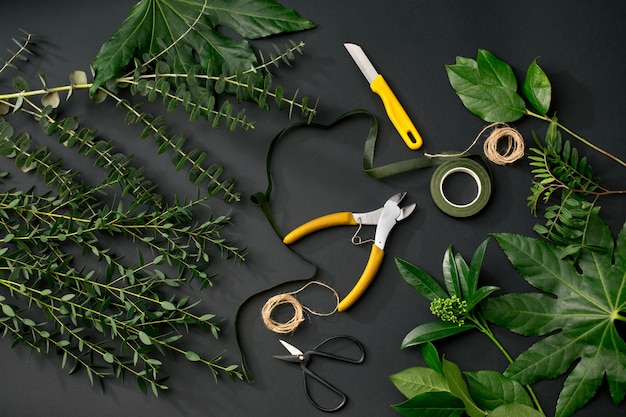 Tools and accessories a florists needs for making up a bouquet Free Photo