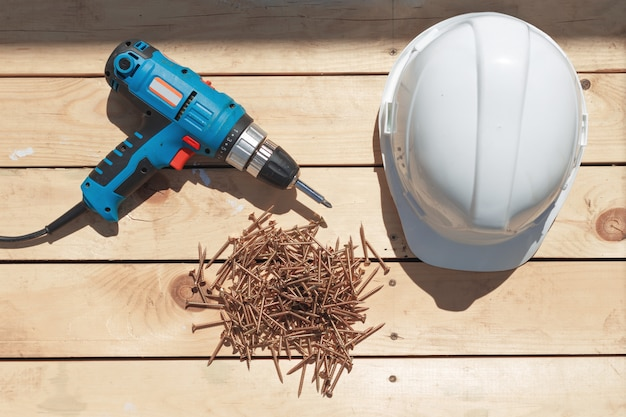 Tools for the construction of a wooden floor or terrace Premium Photo