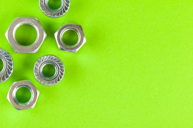 Tools. nuts on green background close up Premium Photo