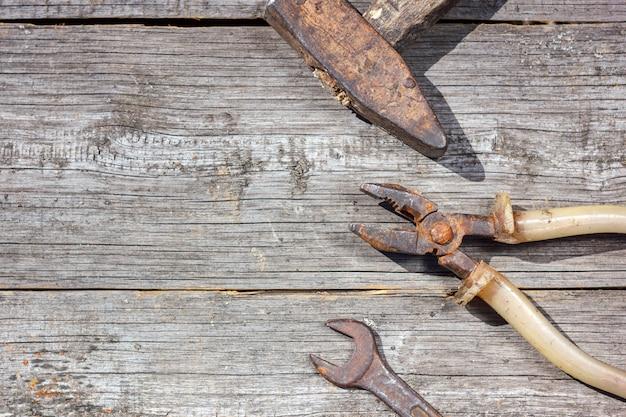 Tools on wooden background Premium Photo