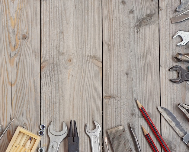 Tools on a wooden floor, top view. Premium Photo