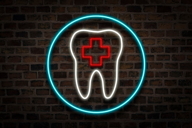 Tooth, neon sign on a brick wall. dental clinic concept, first aid. Premium Photo