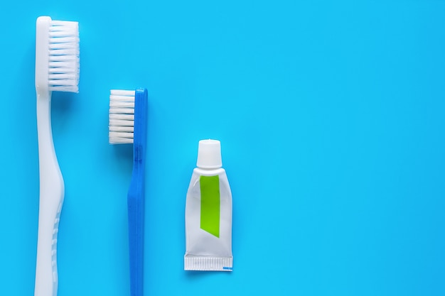 Toothbrush with toothpaste used for cleaning the teeth on blue background Premium Photo