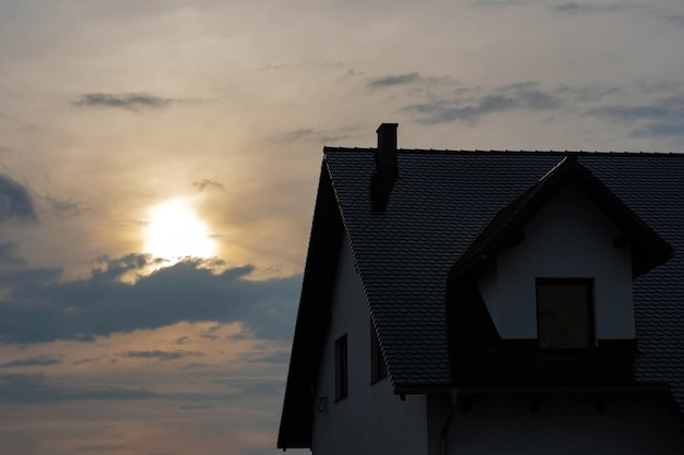 Premium Photo Top Of The House With A Roof And A Loft At Sunset