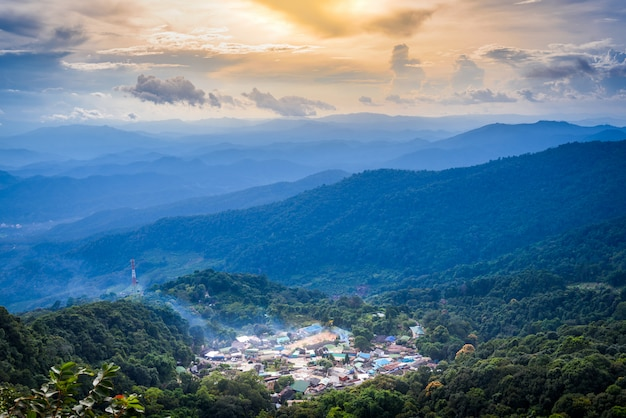 Top landscape view of mountain village on doi pui mountains in sunset sky and clouds Premium Photo