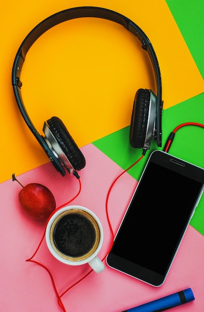 Top view accessories office desk.smartphones headphones on colorful background Premium Photo