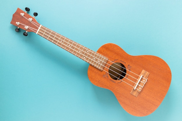 Top view acoustic guitar with blue background Free Photo