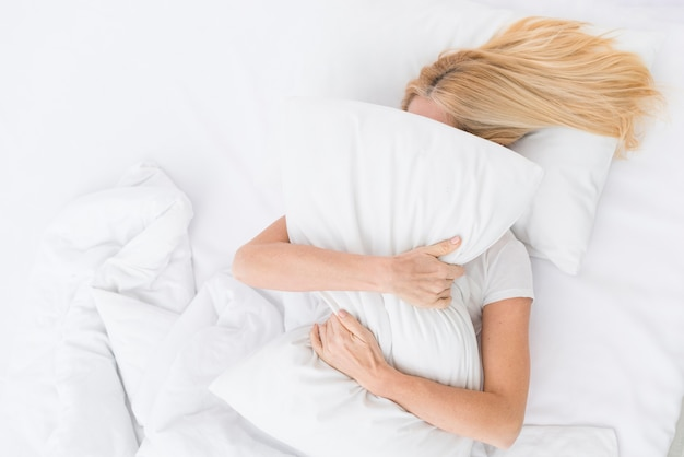 Top view adult female holding a pillow Free Photo
