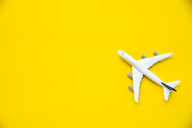 Top view for airplane models on a yellow background. Premium Photo