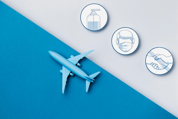 Top view airplane with safety measures logos Premium Photo