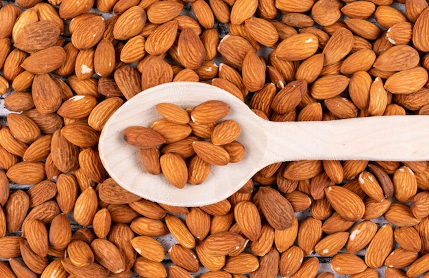 Top view almond in wooden spoon Free Photo