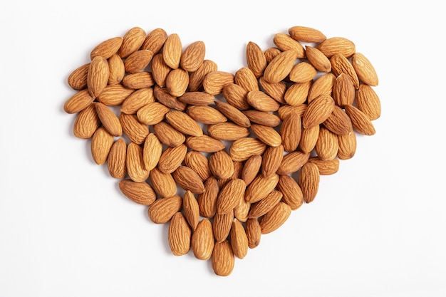 Top view of almonds in heart shape Free Photo