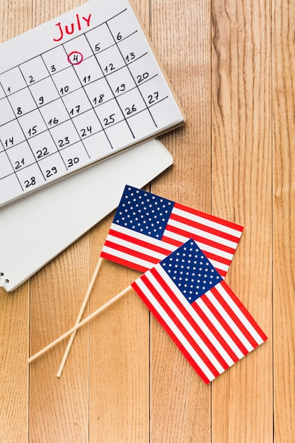 Top view of american flags with calendar Free Photo