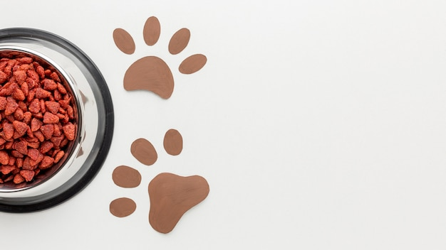 Top view of animal food with paw print for animal day Free Photo