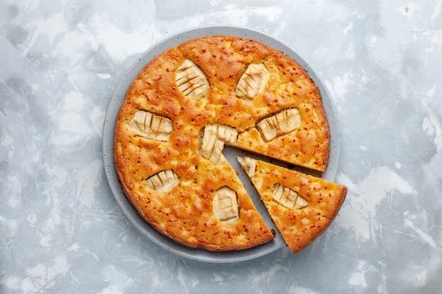 Torta di mele vista dall'alto all'interno della piastra sullo sfondo chiaro torta di zucchero torta di biscotti cuocere dolce Foto Gratuite